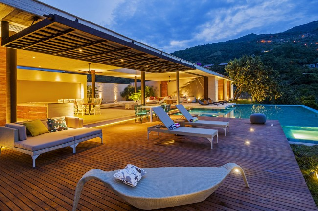 appealing-large-open-plan-home-design-also-wood-pool-decks-with-outdoor-patio-furniture-decoration-and-lounge-chaise-chair-plus-exterior-lighting-ideas